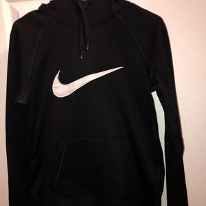 A Nike black pullover w/ Nike logo on the front.